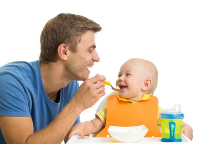 31913648 - smiling baby eating food